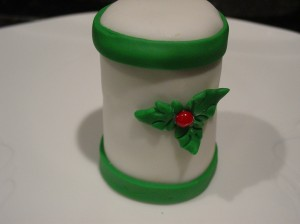holly leaf with red hot cany center on tall cupcake