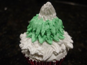 figure piping the Christmas tree cupcake needles from bottom to top