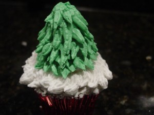 Christmas tree cupcake with all the figure piped tree needles on it