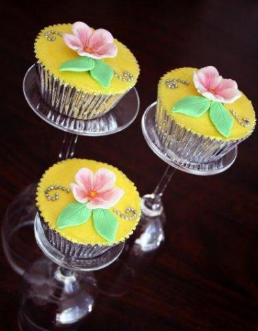 Cupcakes in Champagne Glasses Simple elegant fondant decorated cupcakes in