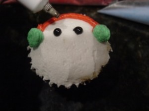 snowman cupcake with black piping gel eyes