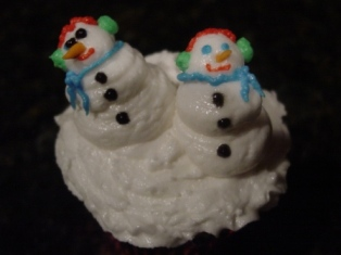 Cupcake With Two Snowmen Figure Piped on Top