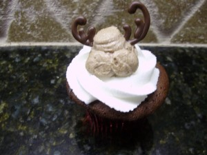 two chocolate antlers on the reindeer cupcake