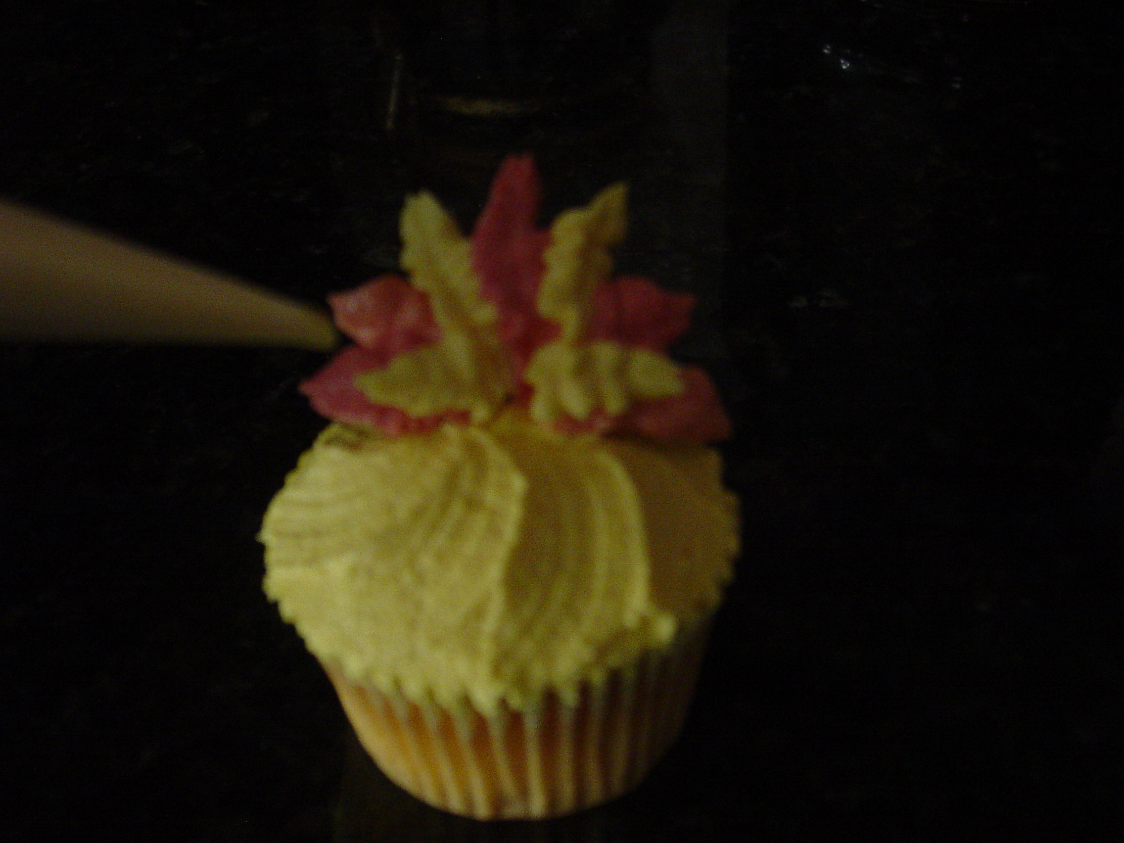 Yellow Iced Cupcake With Turkey