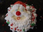 Santa Cupcake Dipped in White Chocolate with Christmas Sprinkles