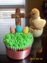 Easter cupcake with cross and chocolate eggs