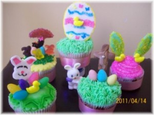 Easter cupcakes displayed on table