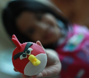 Angry Bird Cupcake with Child Holding one