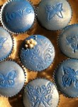 Blue Butterfly Cupcakes Iced with buttercream and fondant