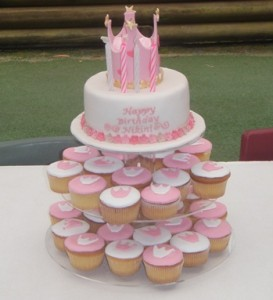 """Princess cupcakes"" on stand with fondant icing crowns."